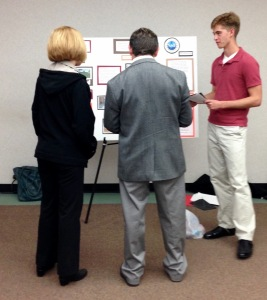 Benjamin Miller talks to Dr. Jerry Weinberg (Graduate School) and Dr. Susan Morgan (School of Engineering) about his poster