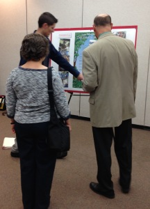 Logan Walker speaks to Dr. Bill Retzlaff (CAS) and Dr. Luci Kohn (CAS) about the finer points of his poster