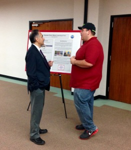 Dr. Parviz Ansari (Provost) shows great interest in Earl Aubuschon's poster